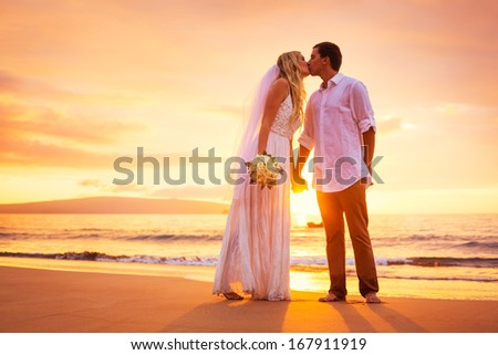 Bride and Groom, Enjoying Amazing Sunset on a Beautiful Tropical Beach, Romantic Married Couple Kissing - stock photo
