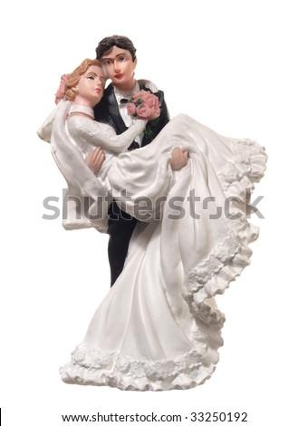 Bride and groom figurines - stock photo