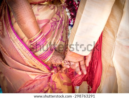 Bride and Groom Hands Together at an Indian Wedding Ceremony - stock photo