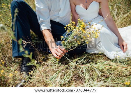 Bride and groom have fun during the wedding day  - stock photo