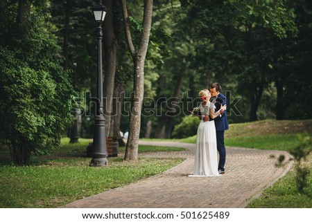 Bride and groom having a romantic moment on their wedding day