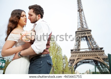 Bride and groom having a romantic moment on their wedding day in Paris