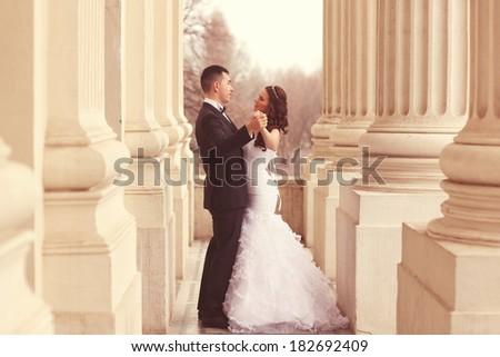 Bride and groom having fun - stock photo