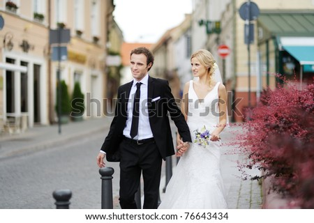 Bride and groom having fun in an old town