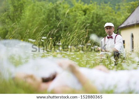 Bride and groom having fun in nature