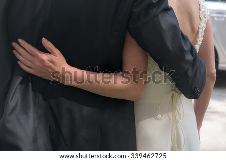 Bride and groom holding each other before the wedding ceremony