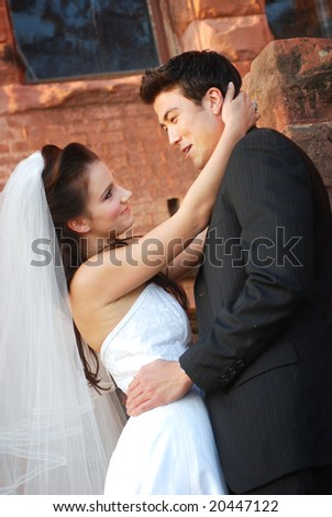 Bride and groom holding each other on their wedding day