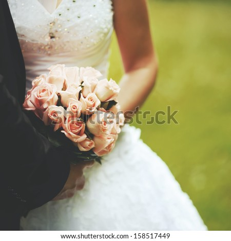 Bride and groom holding hands. Wedding. - stock photo