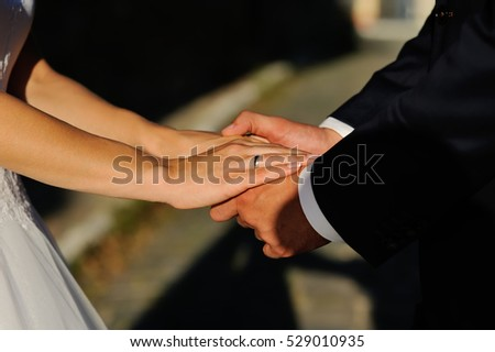 Bride and groom holding hands, Wedding Couple
