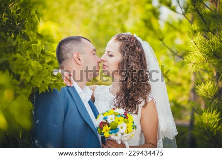 bride and groom in a colorful park