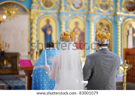 Bride and groom in an orthodox wedding ceremony - stock photo