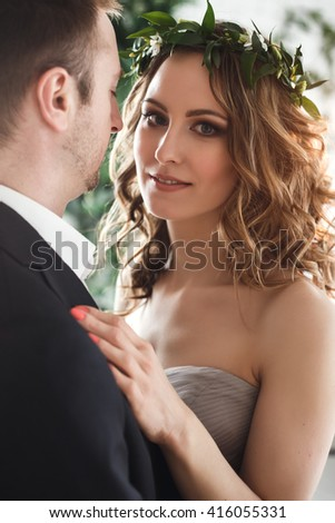 Bride and groom in elegant grey and green style over ecological natural decoration - stock photo