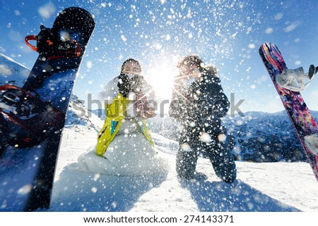 bride and groom in love blow snow background of the Alps Courchevel - stock photo