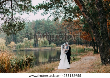 bride and groom in nature - stock photo