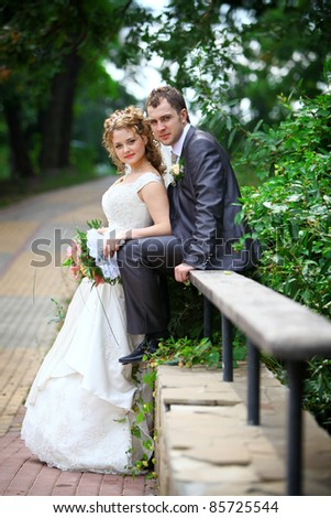 Bride and groom in park - stock photo
