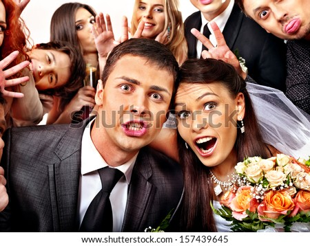 Bride and groom in photo-booth. Wedding. - stock photo