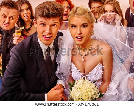 Bride and groom in photobooth making wedding pictures. . - stock photo