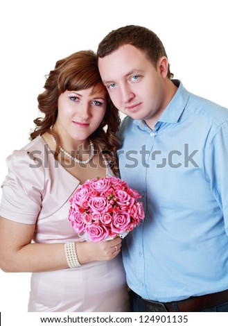 Bride and groom in studio on their wedding day - stock photo