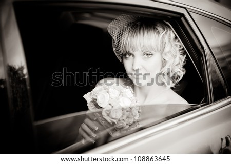 bride and groom in the car. wedding