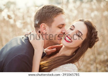 bride and groom in the field with cotton - stock photo