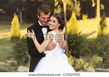 Bride and groom in the garden - stock photo