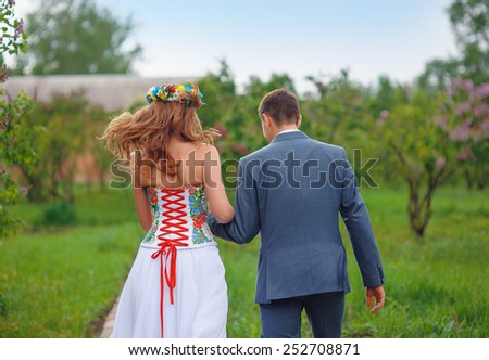 bride and groom in the park. - stock photo