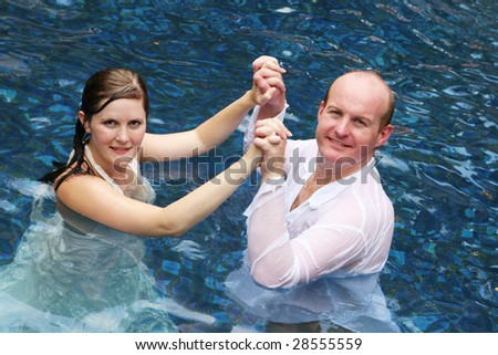 Bride and groom in the water.