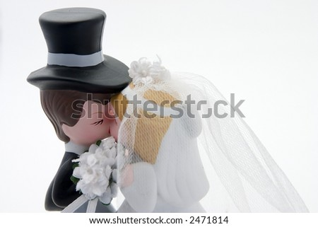 bride and groom kissing - stock photo