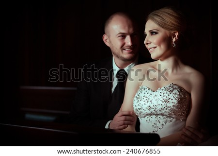 Bride and groom kissing and showing affection in gorgeous luxurious hall.Bride and groom kissing and showing affection.Young happy wedding couple bride and groom on a wedding day - stock photo