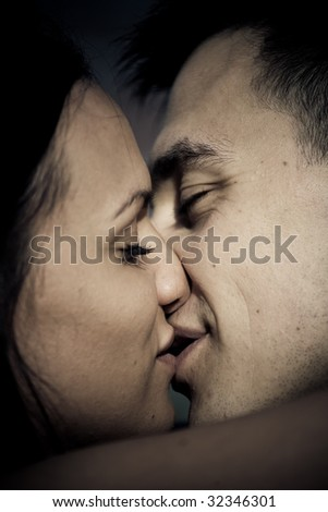 Bride and groom kissing concept closeup