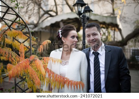 Bride and groom laughing,showing positive emotions and energy.Young happy wedding couple bride meets groom on a wedding day.Happy newlyweds walking casually and showing their happiness. - stock photo
