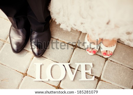 bride and groom legs - stock photo