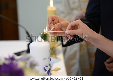 Bride and groom light candle