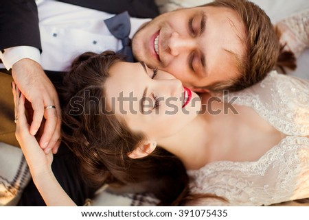 bride and groom lying in the forest