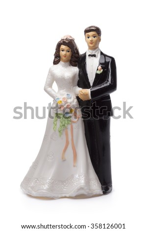 Bride and groom, old cake topper on white background - stock photo
