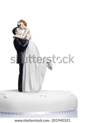 Bride and Groom on a wedding cake - stock photo