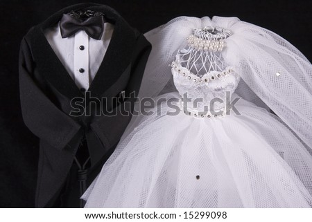 Bride and Groom on Black - stock photo