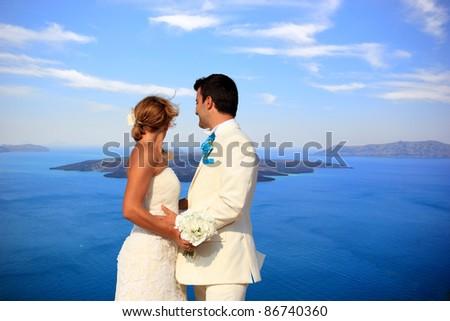 Bride and groom on Santorini island - stock photo