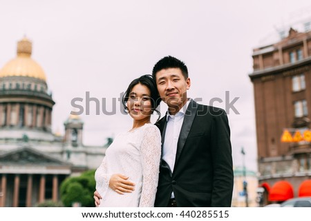 Bride and groom on the background of St. Isaac's Cathedral