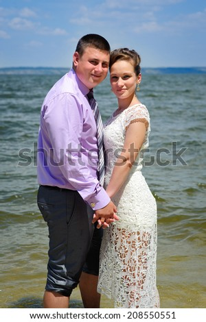 bride and groom on the beach, a wedding bouquet, wedding dresses
