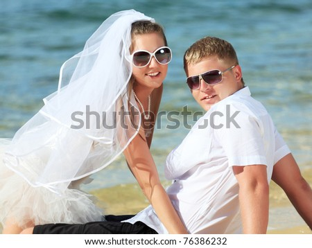 Bride and groom on the tropical beach - stock photo