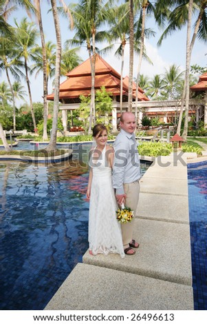Bride and groom on their special day - tropical destination wedding.
