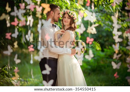 Bride and groom on their wedding day - stock photo