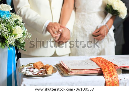 Bride and groom on their wedding day at orthodox church - stock photo