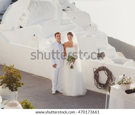 Bride and groom on their wedding day.Ceremony on Santorini.