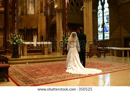Bride and Groom on Wedding Day at Altar (wide angle) - stock photo