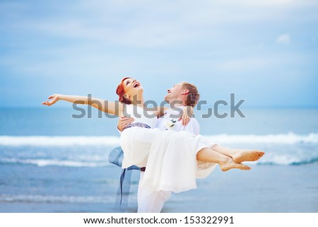 bride and groom on wedding day on the beach - stock photo