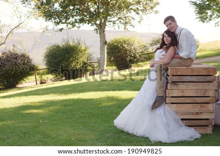 Bride and groom outside church after wedding ceremony - stock photo