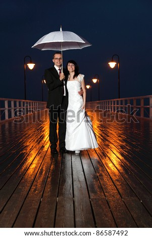 bride and groom, pier night sky light lamp - stock photo