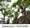 Bride and groom posing summer park outdoors - stock photo